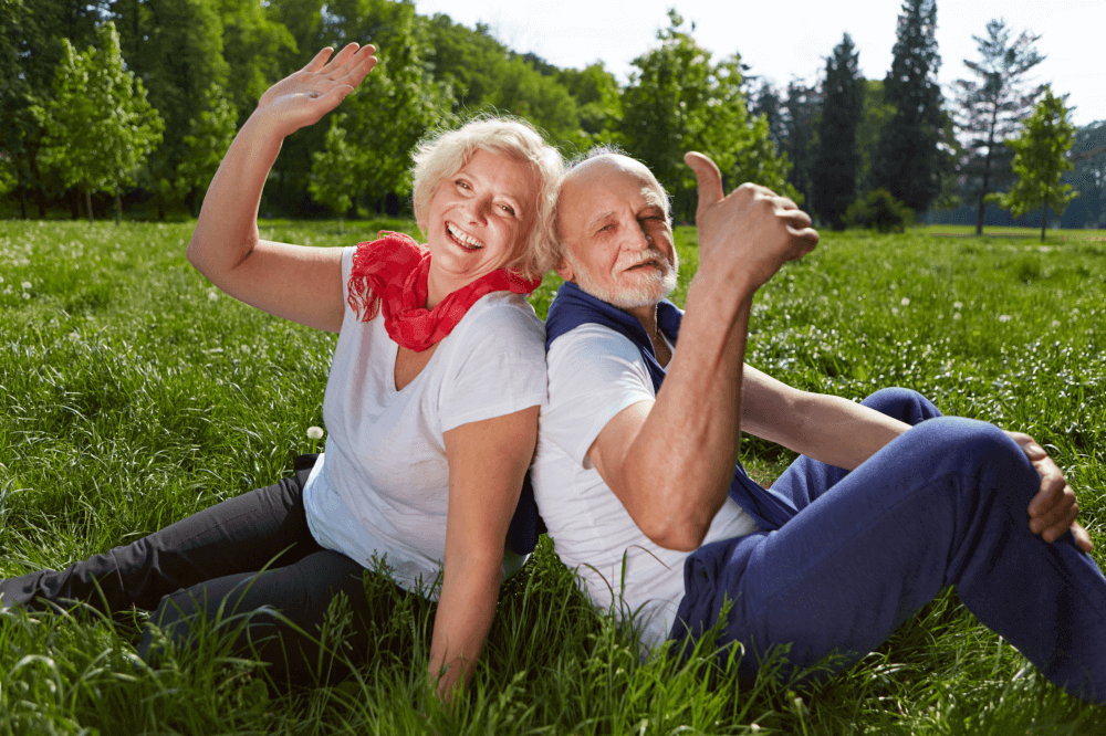 old couple doing thumbs up